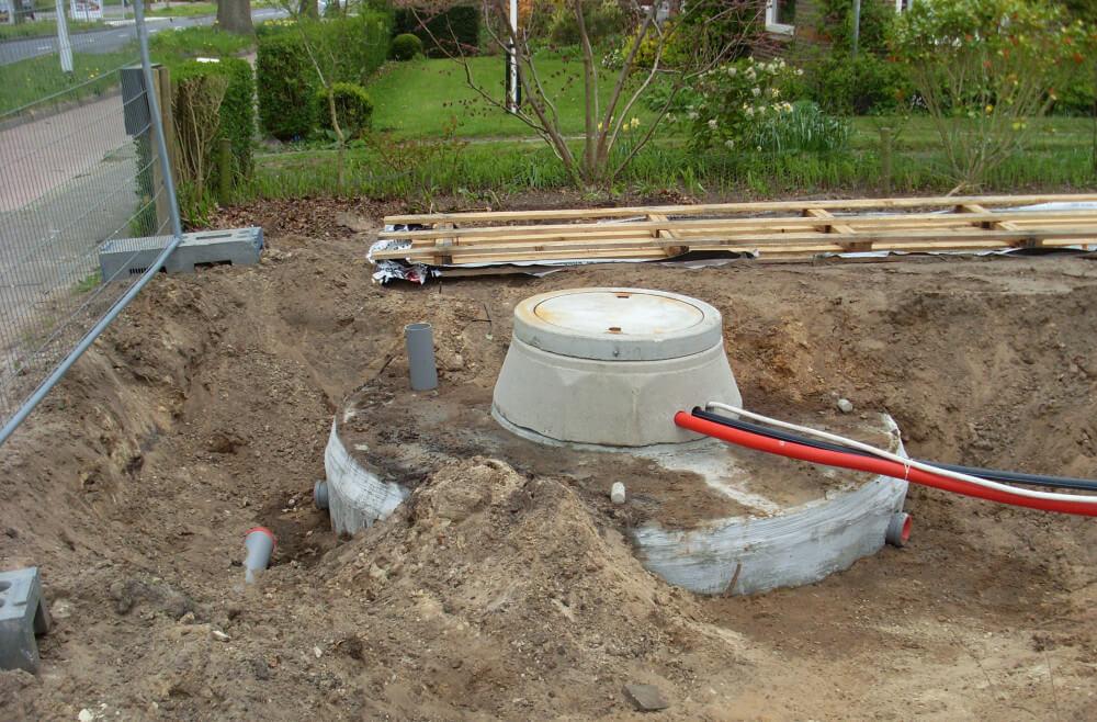 regenwaterput met aansluitingen
